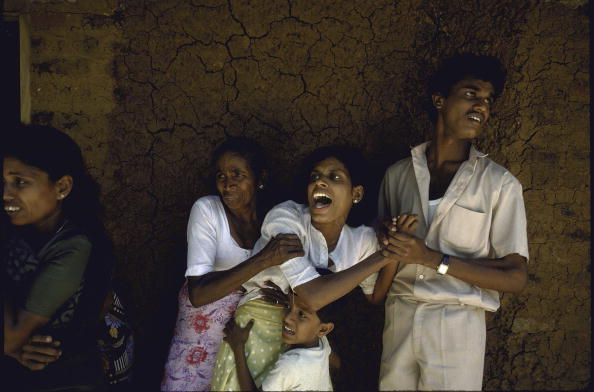 Terrified women and children after army took their husbands for interrogation after terrorist land mine blasts set by extremist JVP-Sinhalese People's Liberation Front.  (Photo by Robert Nickelsberg//Time Life Pictures/Getty Images)