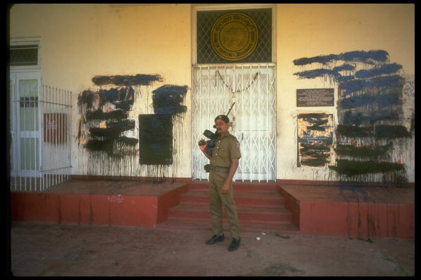 Armed soldier stands before the Bank of