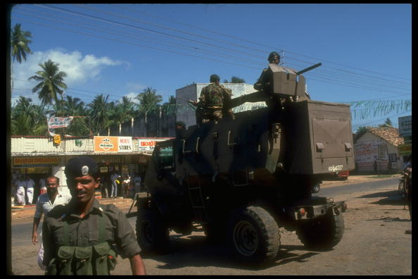 Heavily armed soldiers sit on top of an APC vehicle, rolling down the street. December 1988.(Photo by Robert Nickelsberg//Time Life Pictures/Getty Images)