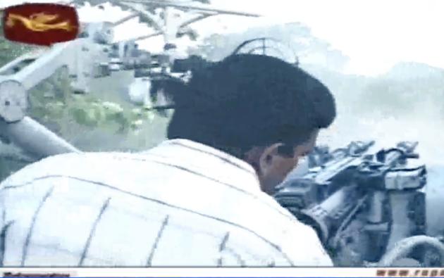 LTTE cadres dressed in civilian clothes firing a ZU-23 heavy machine gun